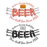 Word beer from sausages roasting on three spits with wood barrel above Royalty Free Stock Images