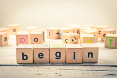 Word ` begin ` wood Cubic on the wood.  royalty free stock photos
