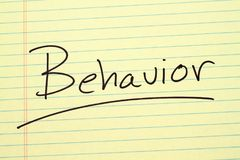 Behavior On A Yellow Legal Pad. The word `Behavior` underlined on a yellow legal pad Royalty Free Stock Image