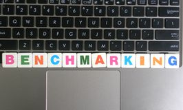 Word Benchmarking on keyboard background.  royalty free stock image