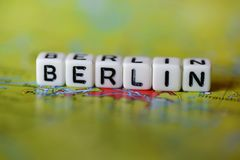Word BERLIN formed by alphabet blocks on atlas map. Geography Royalty Free Stock Image