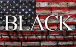 Word black on American flag , crack wall background. Word black on American flag with crack wall background Royalty Free Stock Photography