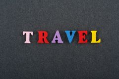 TRAVEL word on black board background composed from colorful abc alphabet block wooden letters, copy space for ad text stock image