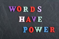 WORDS HAVE POWER word on black board background composed from colorful abc alphabet block wooden letters, copy space for. Word on black board background composed royalty free stock image