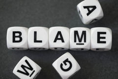 Word blame on toy cubes. Word blame on white toy cubes Royalty Free Stock Images