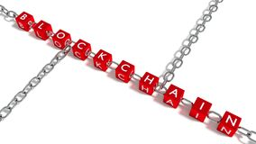 The word blockchain on red cubes connected by iron chain element Royalty Free Stock Photo