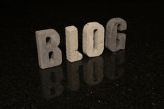 Word Blog as grey concrete letters on black tile Royalty Free Stock Photo