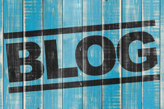 Blog background. Word blog in black letters on grunge blue wooden background Stock Image