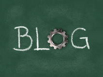 The word blog with gear wheel on chalkboard Royalty Free Stock Image