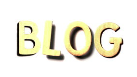 The word blog landing on white surface Royalty Free Stock Photo