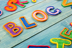 Word BLOG made with plasticine letters on old wooden blue board background. Royalty Free Stock Images