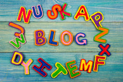 Word BLOG made with plasticine letters on old wooden blue board background. Stock Photography