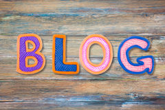 Word BLOG made with plasticine letters on old wooden board background. Royalty Free Stock Images
