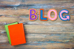 Word BLOG made with plasticine letters on old wooden board background. Royalty Free Stock Photos