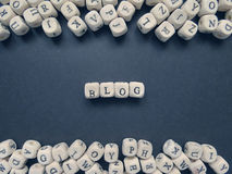 Word Blog of small white cubes on a dark background Royalty Free Stock Images