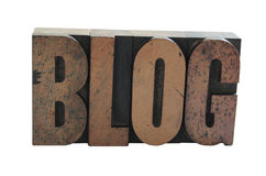 The word 'BLOG' in wood letter. Old, ink-stained wood type letters form the word 'blog' in all caps isolated on white Stock Photo
