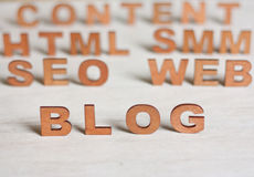 The word blog with wooden letters on a background of blurred let Stock Photo