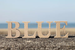 Word blue made with wooden block Royalty Free Stock Photo
