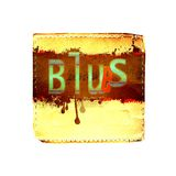 Word `blues` on stitched and dripping leather background. Music element. Royalty Free Stock Photography