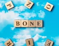 The word Bone. On the sky background Stock Image