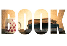 Word BOOK over White mug with many pictured hearts and stack of Stock Photography