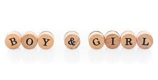 Word Boy & Girl from circular wooden tiles with letters children toy. stock illustration