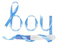 Word boy written gift ribbon. Positive pregnancy test Royalty Free Stock Photo