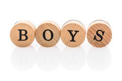 Word Boys from circular wooden tiles with letters children toy. royalty free stock image