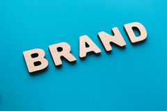 Word Brand on blue background Royalty Free Stock Photo