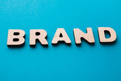Word Brand on blue background Stock Photography