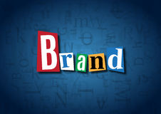 The word Brand made from cutout letters. On a blue background Royalty Free Stock Image