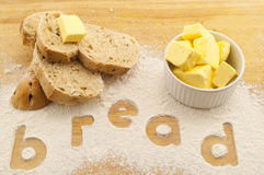 Word bread written in flour bread and butter Stock Photography