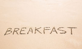 The Word Breakfast Written on the Sand at a Beach Stock Images
