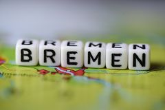 Word BREMEN formed by alphabet blocks on atlas map. Geography Royalty Free Stock Images