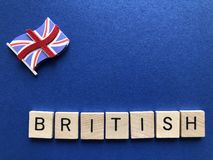 British,  in wooden 3d alphabet letters royalty free stock photography