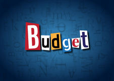 The word Budget made from cutout letters. On a blue background Stock Photo