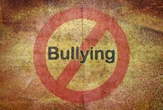 Bullying over traffic sign Royalty Free Stock Photography