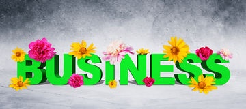 Word business with flowers Royalty Free Stock Photography