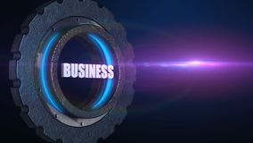 Word business in rotating gear wheel with flare, teamwork business concept stock video footage
