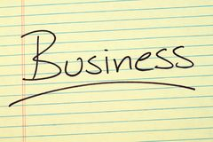 Business On A Yellow Legal Pad Stock Photo