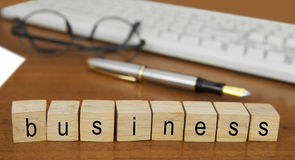 The word business on wood stamp Royalty Free Stock Photo