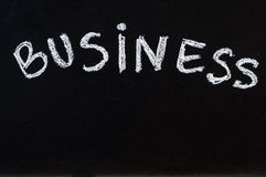 Word Business written with white chalk on blackboard with copy space Stock Photography