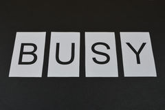 Word Busy on black background Royalty Free Stock Photo