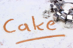 Word cake written in flour and cookie cutters Stock Photo