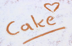 Word cake written in flour Royalty Free Stock Photography