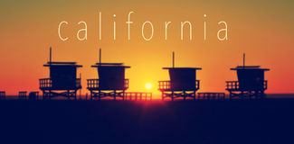 The word California and some lifeguard towers in Venice Beach at. The word California and some lifeguard towers in Venice Beach, California, United States, at Royalty Free Stock Photos