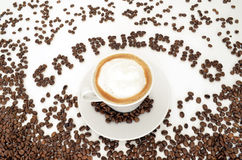 Word cappuccino and  a cup of coffee Stock Images