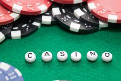 Word `casino` with poker chips and money, gambling concept royalty free stock photos