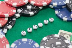 Word `casino` with poker chips and money royalty free stock photo