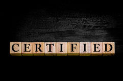 Word CERTIFIED isolated on black background Stock Photo